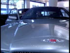 Interest rates may rise ENGLAND London Bentley in car sales showroom MS Man sits at wheel as salesman explains dashboard SOT CMS Bonnet and...