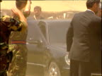 Interim President Hamid Karzai gets out of car to greet UK troops preparing to leave Afghanistan end of War in Afghanistan 2002
