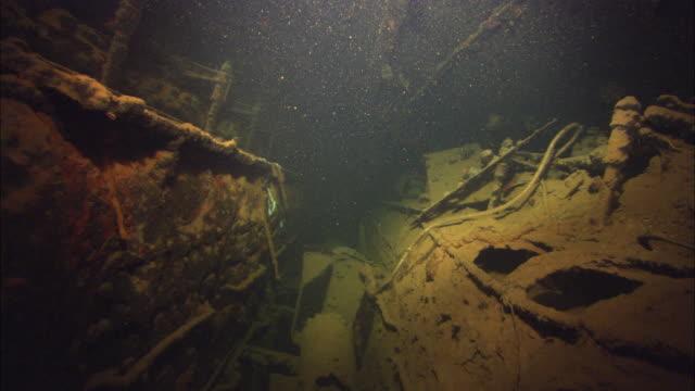 Interior camera in muck, dark with audio. Chuuk Lagoon, South Pacific