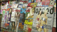 Interior close up shots of lads magazines on display at a newsagent including FHM Loaded Esquire and GQ on August 16 1999 in London England