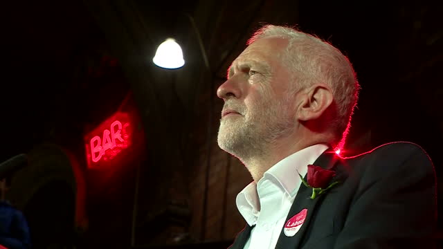 Interior cutaway shots of Labour leader Jeremy Corbyn walking on stage and addressing crowds of supporters at his final rally ahead of the General...