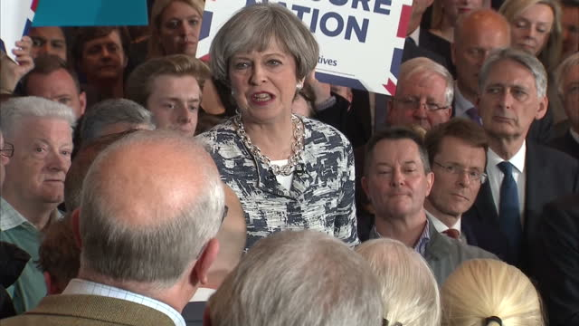 Interior cutaway shots of Theresa May addressing supporters at the final Conservative campaign rally before the General Election with shots of...