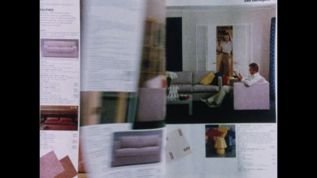 MONTAGE interior design ideas from Habitat shops catalogs / UK / Hand lifts catalog at newsstand / business people look down / stacks of teapots /...