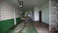 Interior footage of an abandoned corridor in a home in the town of Carolina Puerto Rico on July 9 2017 Shots camera zooms through gate showing...