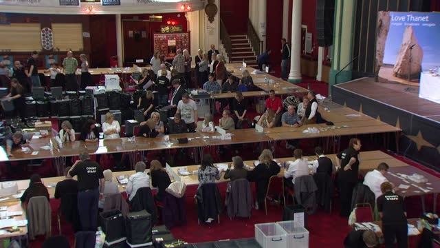 Interior high locked off shot votes being counted in Margate counting hall in Margate Kent