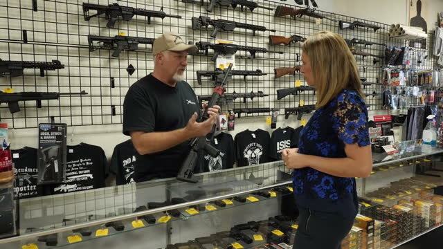 Interior interview with a gun shop owner demonstrating a Springfield AR15 semiautomatic rifle and speaking about the gun control debate in the United...