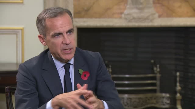 Interior interview with Bank of England Governor Mark Carney speaking about how the bank's decision to raise interest rates from 025% to 05% will...
