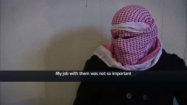 Interior interview with 'Saleh' a former translator for Islamic State speaking about how 'Jihadi John' would treat the foreign hostages well because...