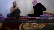 Interior interview with 'Saleh' a former translator for Islamic State speaking about how foreign hostages were made to rehearse mock execution videos...