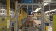KTLA Interior of Amazon Warehouse in San Bernardino Shots of packages going down conveyor belt