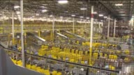 KTLA Interior of Amazon Warehouse in San Bernardino Wide shot of warehouse