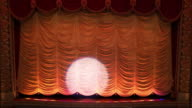 WS HA Interior of Historic Movie Theater, Spotlight Appears On Stage Curtain / Richmond, Virginia, USA