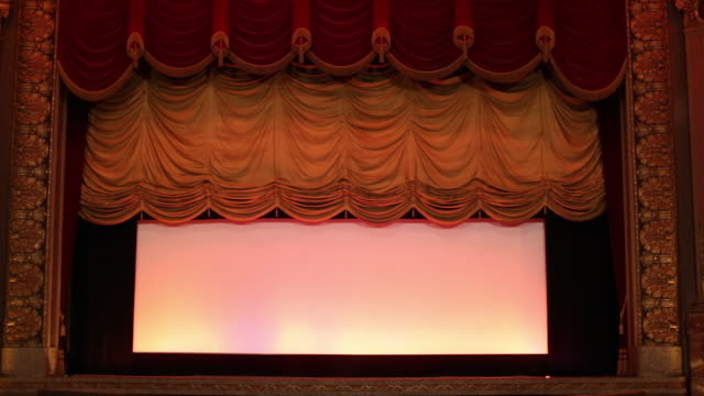 WS Interior of Historic Movie Theater, Stage Curtain Rises / Richmond, Virginia, USA