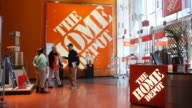 interior of Home Depot entrance at a store located in Manhattan / various signage and logos / shoppers walking in and out of store Home Depot in...