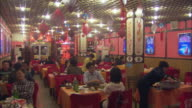 WS Interior of lively Chinese restaurant / Beijing, China
