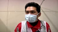 Interior of Red Cross hospital / Red Cross health worker wearing face mask is interviewed 'The common cases are people who lost the medication they...