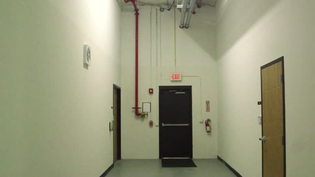 Interior office shots of the Cavern Technologies Data Center in Lenexa Kansas Shots of Long Narrow hallways with expose Granite walls showing...