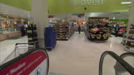 Interior point of view shots down travellator in Tesco store to the bakery section Interior point of view shots along bakery aisles Interior shots...