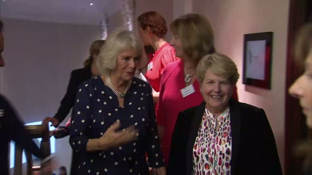 Interior shot Camilla Duchess of Cambridge at the Women of the Year Awards walks and talks to Sandi Toksvig TV personality in London England on...