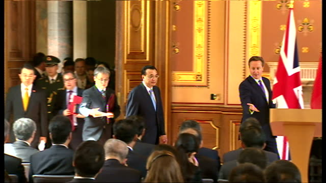 Interior shot David Cameron British Prime Minister and Li Keqiang Chinese Premier walking into room for presser Cameron thanks Chinese Premier for...