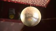 Interior shot gold glitter ball spinning on October 15 2014 in Swinton England