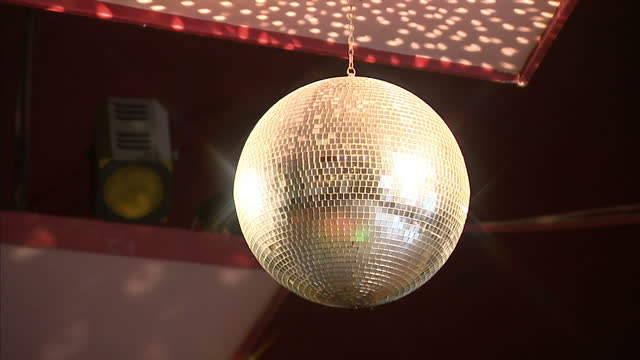 Interior shot gold glitter ball spinning on October 15 2014 in Swinton England
