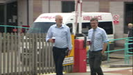 Interior shot Jeremy Corbyn MP Leader of the Labour Party leaves Emergency Department after visit to the Royal Cornwall Hospital walks out holding...