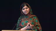 Interior shot Malala Yousafzai acceptance speech thankful for sharing award with Kailash Satyarthi also thanking her father for allowing her to...