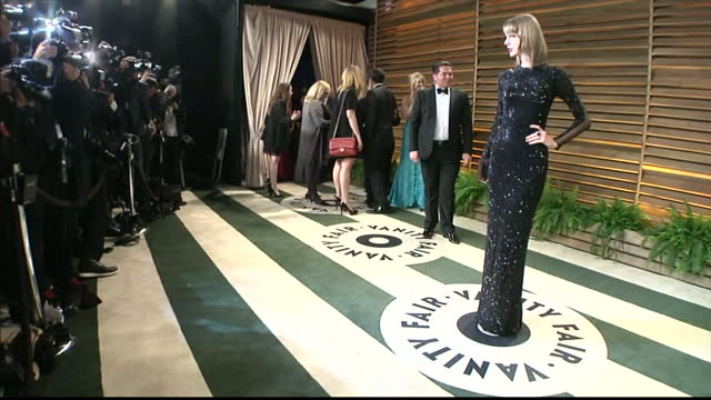 Interior shot Taylor Swift standing on red carpet posing for photographers on March 02 2014 in Los Angeles California