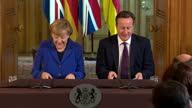 interior shots Angela Merkel and David Cameron walk out to table to begin presser