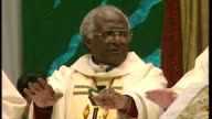 Interior shots Archbishop Desmond Tutu administering mass communion at his last service