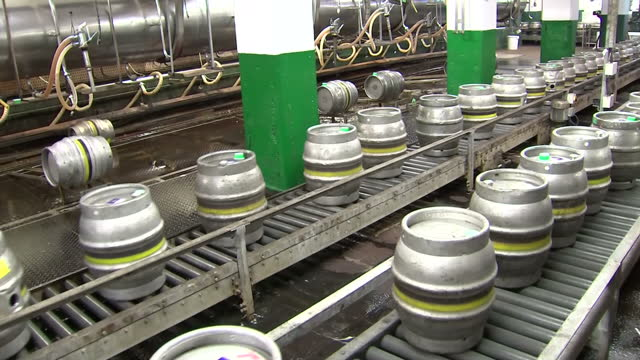 Interior shots beer barrels moving along production line at Marston's Brewery on April 01 2015 in Wolverhampton United Kingdom