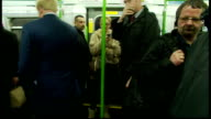 Interior shots Boris Johnson Mayor of London getting onto London Underground train and stands holding support rail Talks to aides and passengers on...
