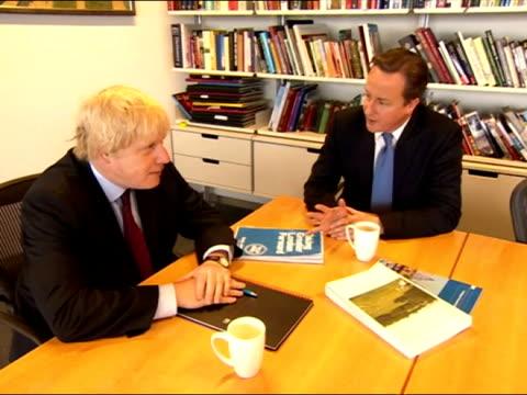 Interior shots Boris Johnson Mayor of London sits chatting with David Cameron inside City Hall Boris Johnson David Cameron at City Hall on May 05...