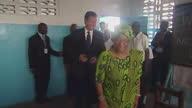 Interior shots British Prime Minister David Cameron Liberian President Ellen Johnson Sirleaf enter classroom welcomed by pupils David Cameron in...