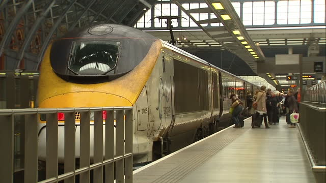 Interior shots busy St Pancras Station passengers on platform alighting train Eurostar train leaves platform on October 13 2014 in London United...