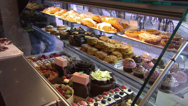 Interior shots cakes and pastries on display in window refrigerator of Patisserie Valerie cafe on October 10 2015 in London England