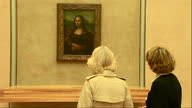 Interior shots Camilla Duchess Of Cornwall looking at the Mona Lisa having picture taken with it Camilla Looking At The Mona Lisa on May 28 2013 in...