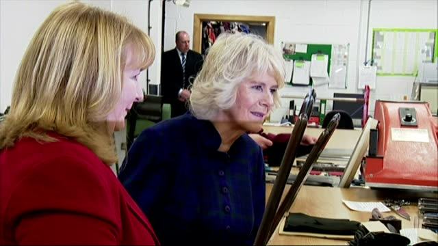 Interior shots Camilla Duchess of Cornwall talking to staff and shown around workshop at Dents Glove Factory on February 24 2015 in Warminster England