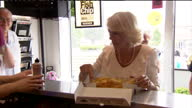 Interior shots Camilla Duchess of Cornwall tries some fish chips in a Fish Chip shop in Bridlington Charles Camilla Visit York Bridlington on July 23...