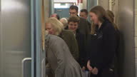 Interior shots Camilla Duchess of Cornwall walking through Battersea Dogs Home talks to staff member looks at dogs through bars on February 01 2017...