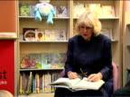 Interior shots Camilla reading poem to children Camilla Duchess of Cornwall Visits West Greenwich Library at West Greenwich Library on February 21...