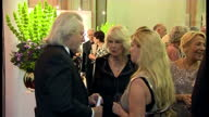 Interior shots Camilla talking to Anthony Clifford Grayling and guest on October 14 2014 in London England