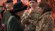 Interior shots Camilla talking to young soldier at barracks other guests Camilla Meeting Young Soldier At Barracks on December 09 2013 in Wiltshire...