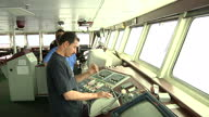 Interior shots captain and staff of ferry in control room exterior shots of ferry deck and waves over side on April 23 2011 in Az Zawiyah Libya