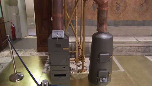 Interior shots chimney flue in Sistine Chapel tilt up and down to burner with on off switch Chimney and burner in Sistine Chapel on March 09 2013 in...