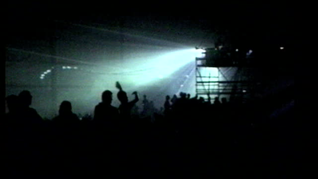 Interior shots clubbers dancing and raving to club music at warehouse rave on March 09 1990 in London England