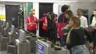 Interior shots commuters passing through ticket barriers at Brixton Underground Station on first night of the 24 hour night tube service on August 19...