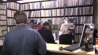 Interior shots customers in busy 'sister ray' record store browsing vinyl records records queueing at counter on April 18 2015 in London England