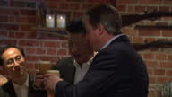 Interior shots David Cameron British Prime Minister and Xi Jinping Chinese President arrive at The Plough pub and sit at bar drinking beer on October...